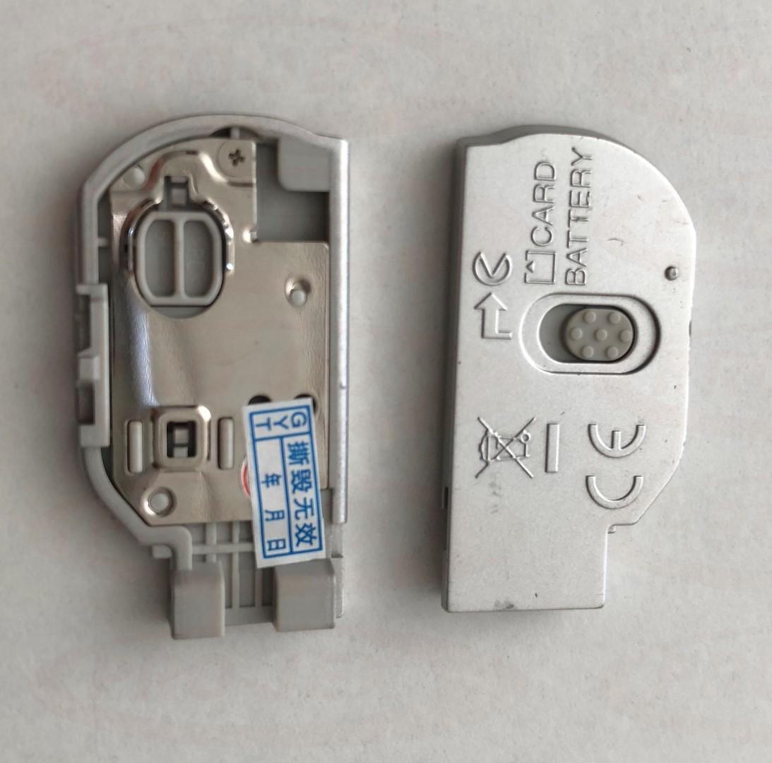 Klapka baterii NIKON L19 srebrna